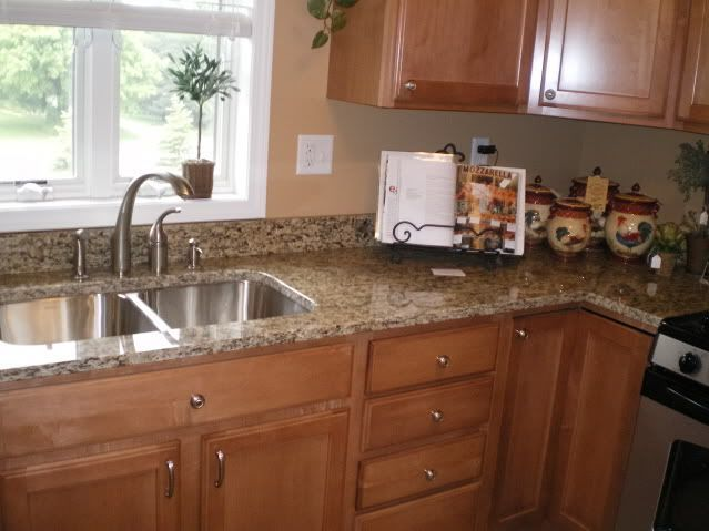 """We are 98% finished with our kitchen layout, and are moving on to countertop selection. Our cabinets will be cherry with a """"ginger"""" finish; flooring will probably be a natural oak (to match existing flooring) but in any event will be light in color. We had originally focused on quartz (Zod..."""