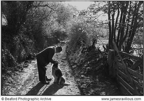 Archie Parkhouse with his dog Sally, Millhams, Dolton, Devon, England, 1982