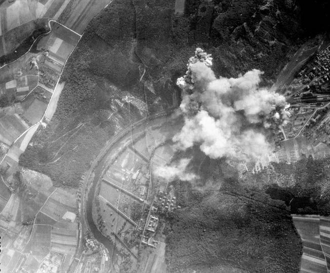 Bombs rain on military targets in and around the city of Münster, Germany. Ben Kuroki nearly lost his life on a mission to Münster when German flak tore through his .50-caliber gun turret aboard a B-24 Liberator bomber.
