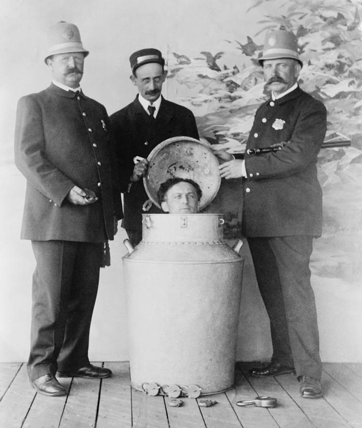 """Harry Houdini photographed in a milk can (almost """"past his eyes"""")."""