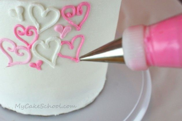My Cake School - 100 hearts cake.  Variety of hearts randomly piped all over cake - tips 3, 4, and 16 - or whatever tips you can use to make hearts.