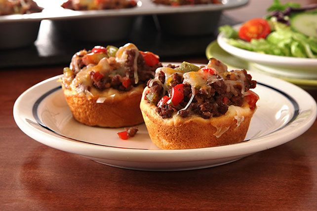 A tasty mixture of ground beef, peppers and cheese are blended with BBQ sauce and pressed into refrigerated biscuits to make this fast weeknight dish.