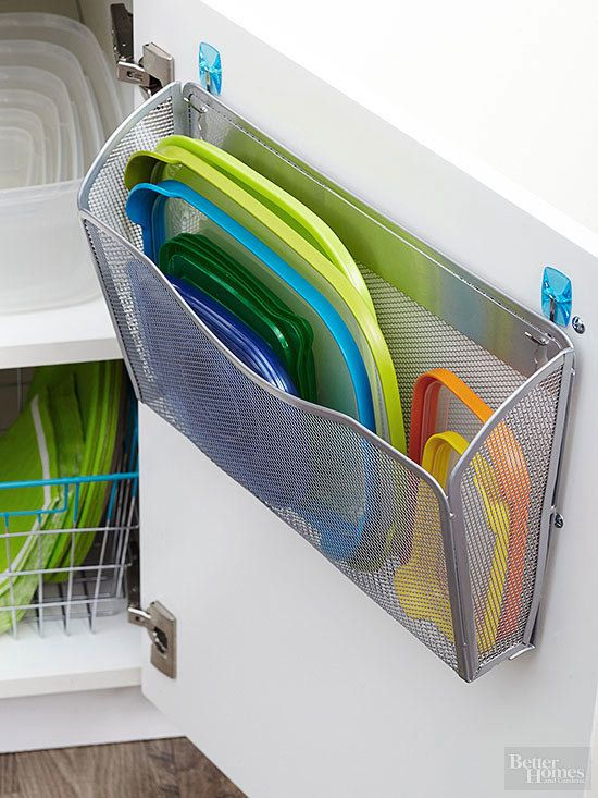 Hang an office file organizer on the inside of your tupperware cabinet to keep up with the lids. | 42 Brilliant Ways To Binge Organize Your…