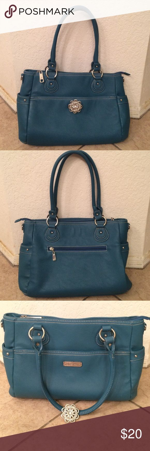 Grace Adele Handbag Cute barely used and in great condition Teal Grace Adele handbag. Comes with a detachable clip/brooch. Lots of storage compartments to keep everything organized! Grace Adele Bags