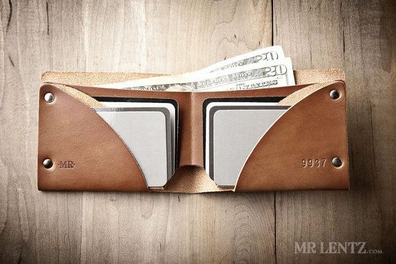 Out in the West a dusty sun sets, and this bifold leather wallet reflects the warm glow. Its design was meant to mimic those final moments of light