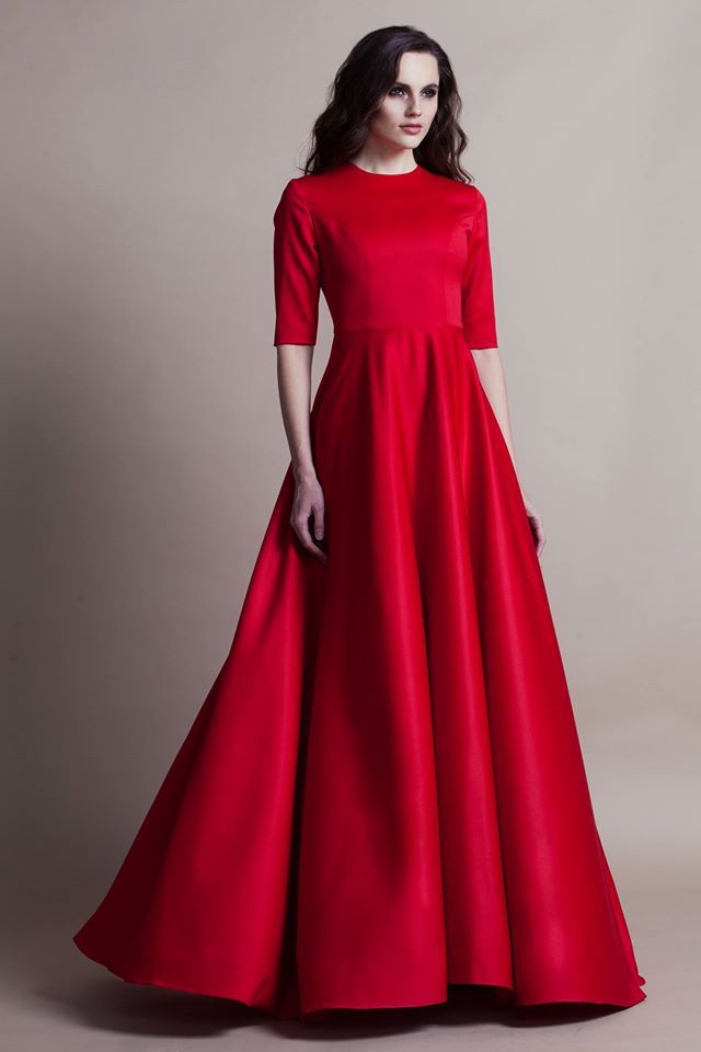 High-waisted half-sleeve A-line cherry gown, pink lips, wavy raven mane swept back