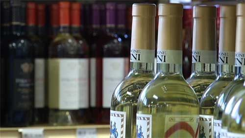 Dozens of bottles of low-priced California wines sold under such labels as Franzia, Mogen David and Almaden contain dangerously high levels of arsenic, according to a lawsuit filed by four Californ...