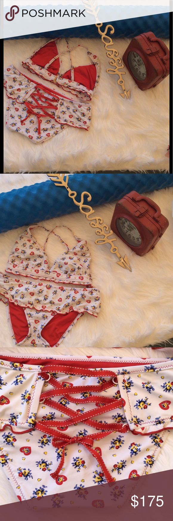 Betsy Johnson Bikini Hard to find!  Oh how I hate parting with this, but I can't reverse time. It deserves a great home.  This rose bikini is super special. Top is a D. It has removable padding, beautiful adjustable hook band around back and cris cross straps on back with gold hearts to adjust with. Bottoms are large. They are sweet!  Mini attached shirt for that perfect flair tease. A bright red ribbon ties down into a bow. Can be tightened or loosened.  Worn once. Sexy!!!  Mint condition…