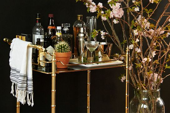 """We're Obsessed With This NYC Apartment's Incredible Look #refinery29  http://www.refinery29.com/alia-ahmed-yahia-apartment#slide10  A chic, gold bar cart greets guests in the entryway. As avid hosts, Alia and Peter each have signature drinks that they serve at dinner or cocktail parties. Hers, appropriate called the """"Ahmed-Yahia,"""" features 1 shot of apple jack, 1/2 shot of bourbon, 1/2 shot of ginger beer, and a touch of simple syrup. At their last party, they handwrote drink recipes on ..."""