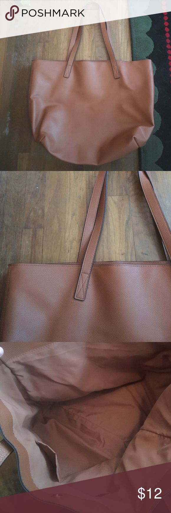 "Faux Leather Brown Tote Bag Holds so much stuff! I only use backpacks so I don't use this! Never used! In perfect condition. 18""x13""x7"". 12"" straps Old Navy Bags Totes"