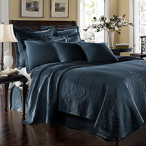 I know you said no blue on the walls but this is stunning and would pick up the blue in the print of the boy sleeping.  It would also pair well with gray walls and the earth tones of the animal skins and ...deer heads.  King Charles Matelasse Coverlet in Provincial Blue