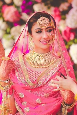 Meet The Indian Bride - Kiran | Gorgeous Pink Lehenga with Polki Kundan Choker, Polki Kundan Chandbalas, Polku Kundan Maang tikka and Jhoomers, and Pearls and Gold Nose Ring, Smokey Eye Makeup with Hot Pink Matte Lipstick. Photography by Arjuns Tryst with the Camera. @wedmegood #bride #wmgbride #indianbride