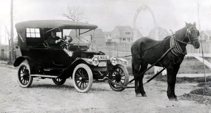 "Clinton Folger's ""Horsemobile"" delivering mail, on South Beach Street, at Hayden's Bath House entrance. From 1900 to 1918, Nantucket was the only place in the nation that successfully banned the automobile within its limits. On May 15, 1918 the law was overturned and the automobile was allowed entry. Clinton Folger was the mail carrier for Nantucket. Because cars were forbidden by the town, he towed his car to the state highway for driving to Siasconset."