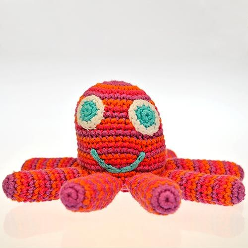 This popular Pink/Orange/Purple Crocheted Octopus toy has been handmade by the ladies of Hathay Bunano in Dhaka, Bangladesh.  Part of the 'Pebble' range of baby toys, it has big eyes, a friendly smile and a rattle inside. Babies love to get hold of one tentacle and wave it about!  Machine washable - 100% Cotton outer - Polyester fill - Suitable from birth  Diameter : 70mm Height : 135mm Tentacle Length : 70mm