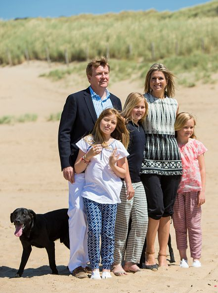 (L-R) King Willem-Alexander, Princess Alexia, Princess Amalia, Queen Maxima and Princess Ariane of The Netherlands and one their dogs Skipper and Nala pose for pictures on July 10, 2015 in Wassenaar, Netherlands.