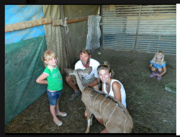 Me and the kids with a Kudu calf. — in Jansenville, Eastern Cape, South Africa.  http://www.facebook.com/pages/Alisons-Favorite-Things/201025116635827