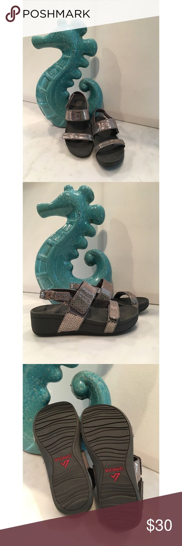 🌴Vionic Strappy Pewter Sandals🌴 Comfortable and stylish sandals from Vionic. Theses are a pewter metallic color that goes with everything. Each strap is adjustable to your foot with Velcro that is in pristine condition. Dark grey soles. Great condition. Vionic Shoes Sandals