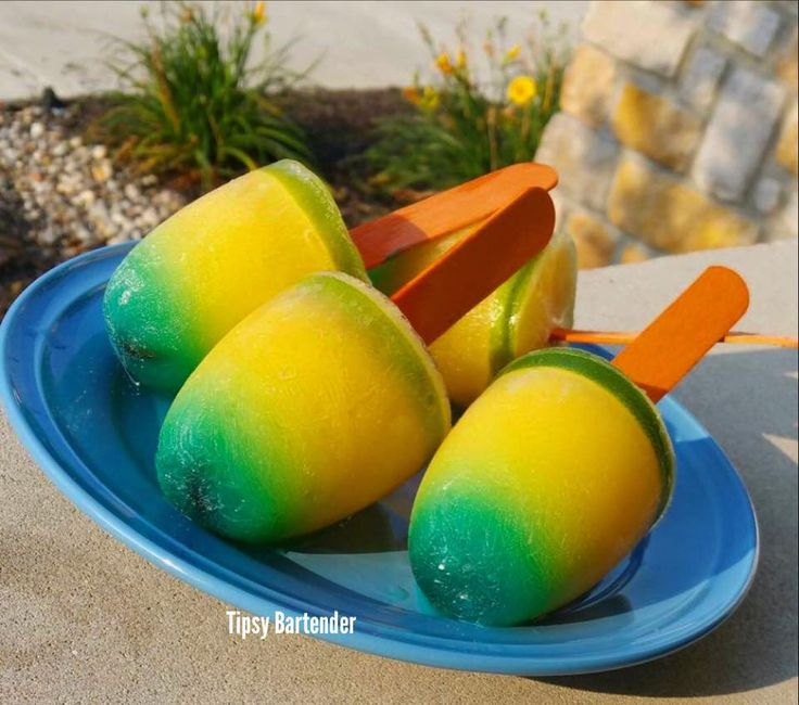 The Blue Tequila Sunset Popsicles! You can't go wrong with these on a hot Summer day! For the recipe, visit us here: www.TipsyBartender.com
