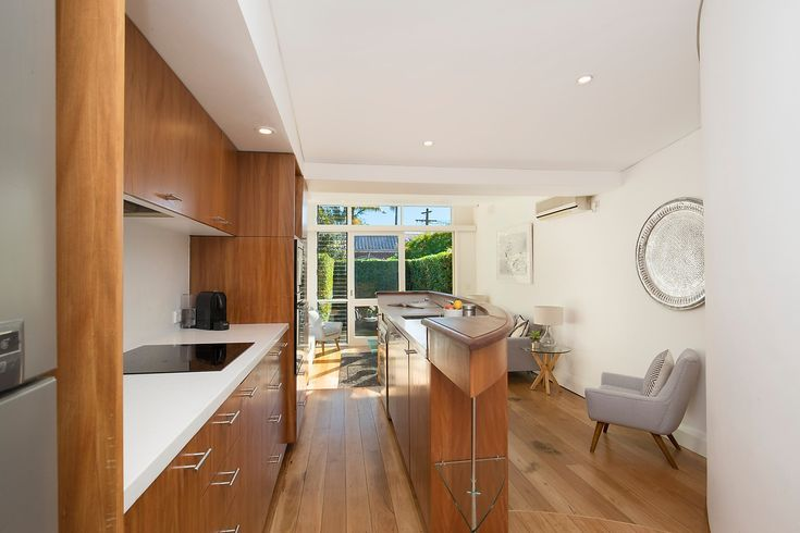 Modern kitchen, abundant storage, timber, wall art, sitting chair, pretty terrace, immaculate interiors, 20 Ferris Street, Annandale, Pilcher Residential