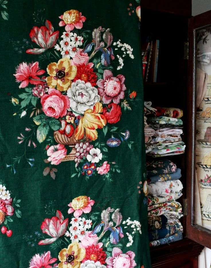 Floral-wallpapered linen cabinet.