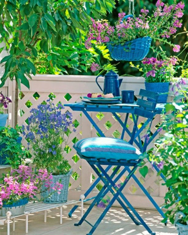 Paint the furniture and baskets blue and choose flowering plants for contrast