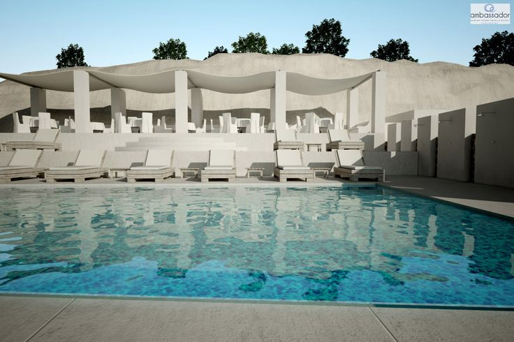 Sundrenched dreams and velvet waters – Santorini magic! More at ambassadorhotelsantorini.com