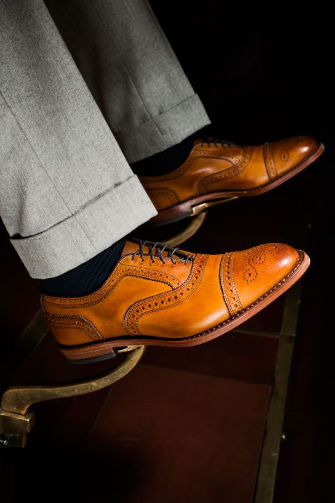 Brogues actually started out as hard-wearing shoes for men trudging through Irish bogs—hence the holes, which went all the way through and allowed water to drain out. Now, the broguing is purely decorative, and the shoes themselves are at home just as much in the office as they are in the countryside. Strand cap-toe oxfords ($395) by Allen Edmonds, allenedmonds.com
