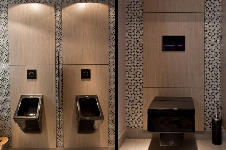 Ultra modern restrooms. Use black sanitaryware and an LED touchless flush plate for a sleek look in restrooms. Copyright The Designer Knowledge. Photo by Ani Evans Photography.