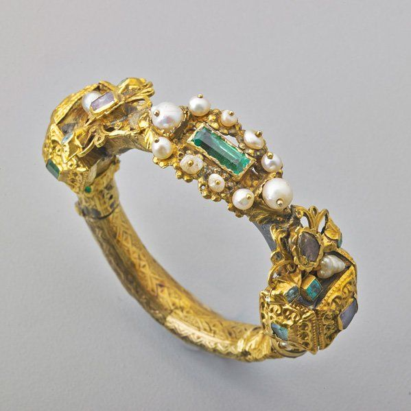 SPANISH SHIPWRECK SALVAGE GOLD EMERALD BRACELET. Revised or assembled hinged gold bracelet rebuilt of gold (various alloys), emeralds, and foil-backed diamonds with pearls, lead solder apparent. Parts found off the coast of Florida. 16th-19th c.