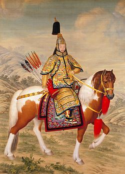 The Qianlong Emperor in ceremonial armor on horseback.  The Qianlong Emperor is wearing his dress war helmet, which is inlaid with pearls, tourmaline and ruby gem stones, Qianlong period (1736 AD-1795 AD), Qing Dynasty.