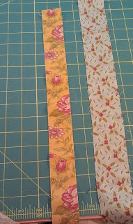 VERY COOL way to machine bind your binding.you cut one fabric 1 and then you use another fabric and cut it 2 1/2You sew it to the BACK of your quilt with the 1 piece laying on the quilt. The 2 1/2 fabric should be facing up.