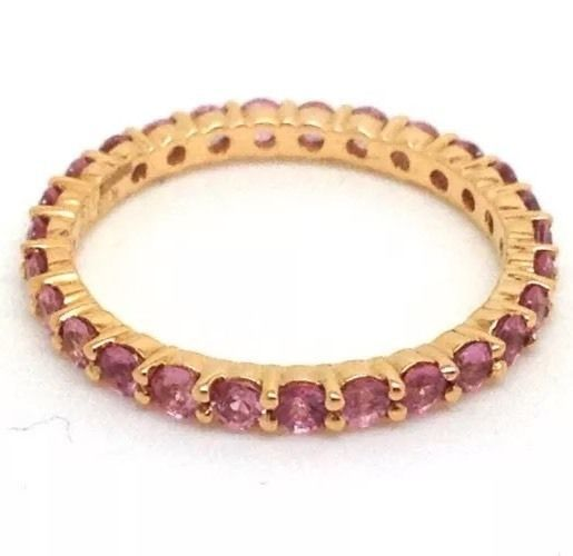 UK size L. This is quite small, not L for large! (2 sizes smaller than average lady ring finger size). Round-cut real pink sapphires set the whole way around the ring. Full eternity rings are very difficult to resize as the stones go all the way around the ring, so I would say it cannot be resized. | eBay!