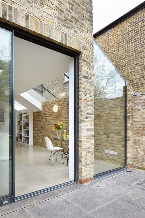 London house extension creates light-filled kitchen and dining room that opens up to the garden