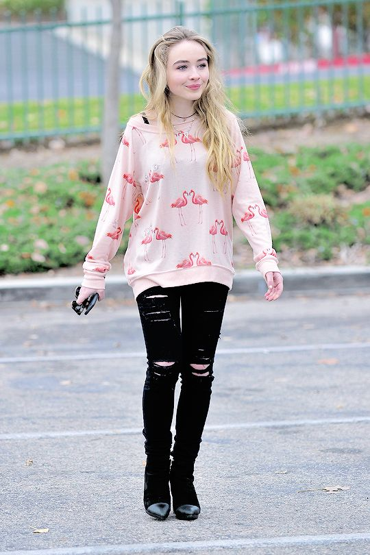 Ripped jeans, graphic sweater, boots: Sabrina carpenter has it down!!