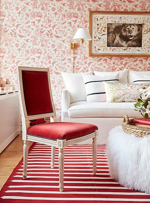 """This red-and-white cotton dhurrie """"ties the whole room together,"""" Zanna says. """"And it's one of those fabrications that's going to be easy to wash as well, which if you've got two toddlers you've got to think about."""""""