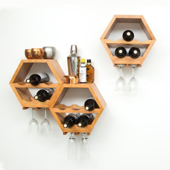 Listing Information ------------------------------ These hexagon wine racks are perfect whether you want a stylish way to store a few bottles, or youre looking for an efficient way to keep your cellar collection organized. Each hexagon hangs individually and holds up to 7 bottles without any wasted space, so you can arrange them in any configuration that works for your aesthetics & wall space! While the racks come ready to hang, they work just as well on counter tops and tables! This lis...