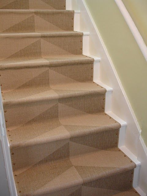How to install inexpensive Ikea rugs as a stair runner. Beautiful!
