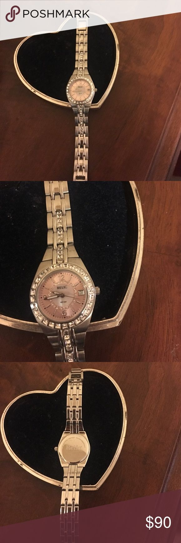 Beautiful Relic watch ⌚️ This is a beautiful watch! I got as a gift but I'm not a watch person and I just held onto it because it was so nice lol 😊. It will make someone very happy I'm sure 💖💕💖💕. This watch is 114.89 on eBay I'm asking for $90 this is firm! Relic Accessories Watches