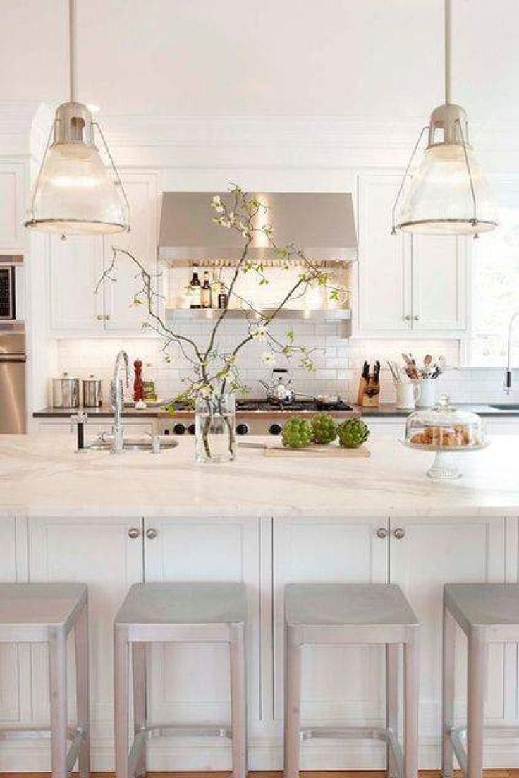 kitchen stools, bar stools, kitchen benchtop, marble, white kitchen. Cupboards at back of bench great idea!