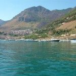 """View from the sea. The coast of Castellammare is one of the most beautiful of Sicily. Besides the beautiful coves """"Cala Bianca"""" and """"Cala Rossa"""", the coves with crystal clear waters of the Zingaro nature reserve attract thousands of visitors every year."""