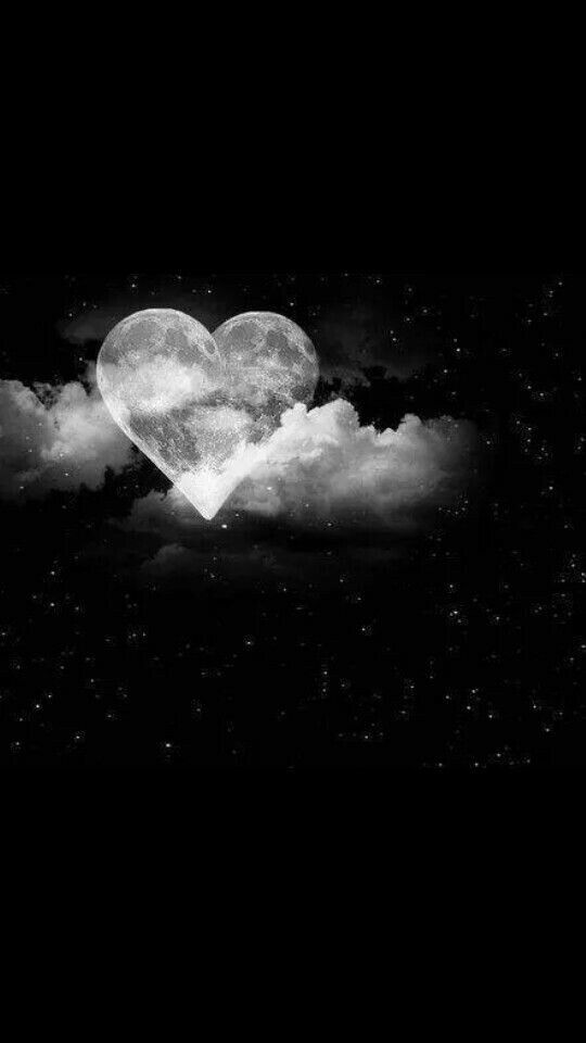 Black & white, heart shaped moon; alone in the clouds