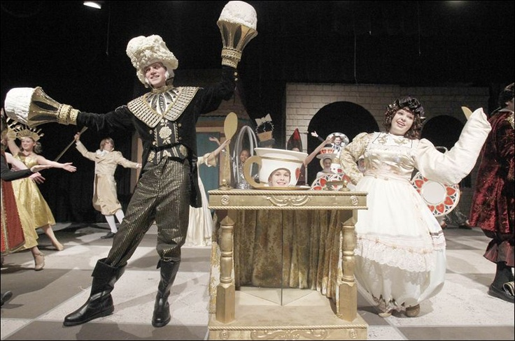 "Dillon Cordray, left, who plays  Lumiere, Bryce Stevens, center, who plays ""Chip"", and Chelsea Smith, right, who plays Mrs. Potts, perform a scene during rehearsal for Bedford High School's  performances of Beauty and the Beast. THE BLADE/AMY E. VOIGT--love the cart for Chip"