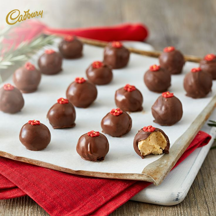 Looking for something super easy and delicious to make for your friends and family this long weekend? Try this enticing Truffles Recipe - the ginger and chocolate combo with have everyone coming back for more!  #CADBURY #CadburyKitchen #chocolate #truffles #trufflerecipes #dessert #dessertideas