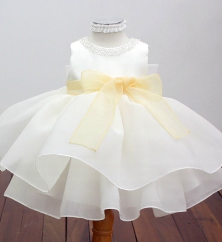 Beaded Applique Dress---Made To Order - High Quality Beaded Neckline Applique Light Yellow Bow Sash Belt Sleeveless Tiered Layered Knee Length Little Girl Party Dress. Material: satin, tulle mesh, soft polyester and purified cotton lining. Available from Newborn - 15 Years. Please do compare your  little girl measurements with our size chart or you may leave a note your little girl's height, bust and waist measurements so we can process it and send you the right size. Thank you for choosing…
