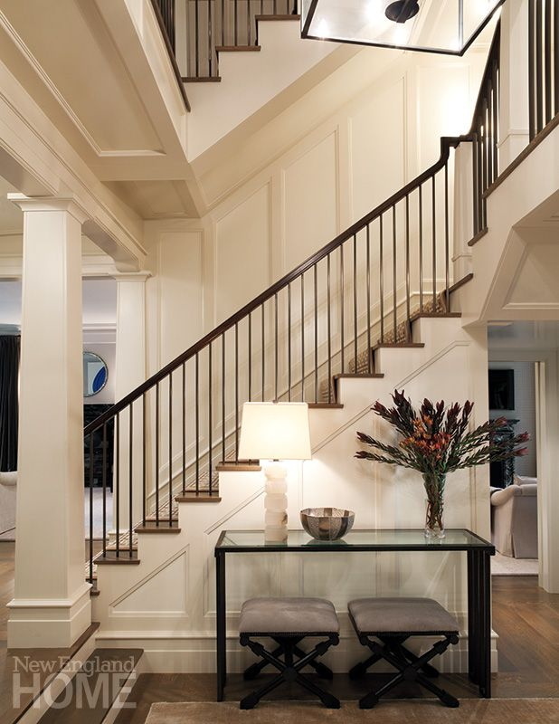 House Foyer Features : A step down foyer features staircase with balusters of