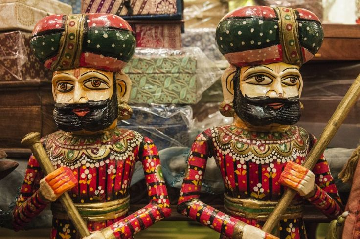 Hand-painted wooden Rajasthani Royal Guards stand watch over stacks of tiny boxes for hidden treasures.