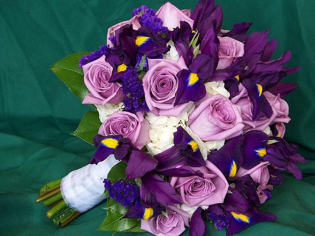 Lavender roses mixed with dark purple Iris, set into white hydrangea. A perfect springtime wedding bouquet!