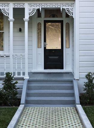 All White Exterior Dark Blue Door Grey Steps