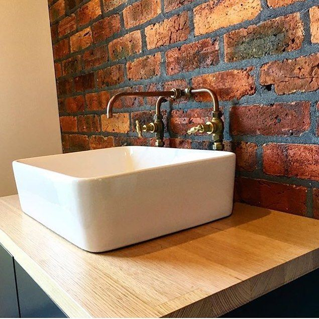 Home made copper taps by @pauls_plumbing. Exposed brick wall. Timber topped vanity with square basin. #taps #interiordesign #bathroom #australia #architecture #bathroomdesign #bathroomcollective Visit our website for more www.bathroomcollective.com.au