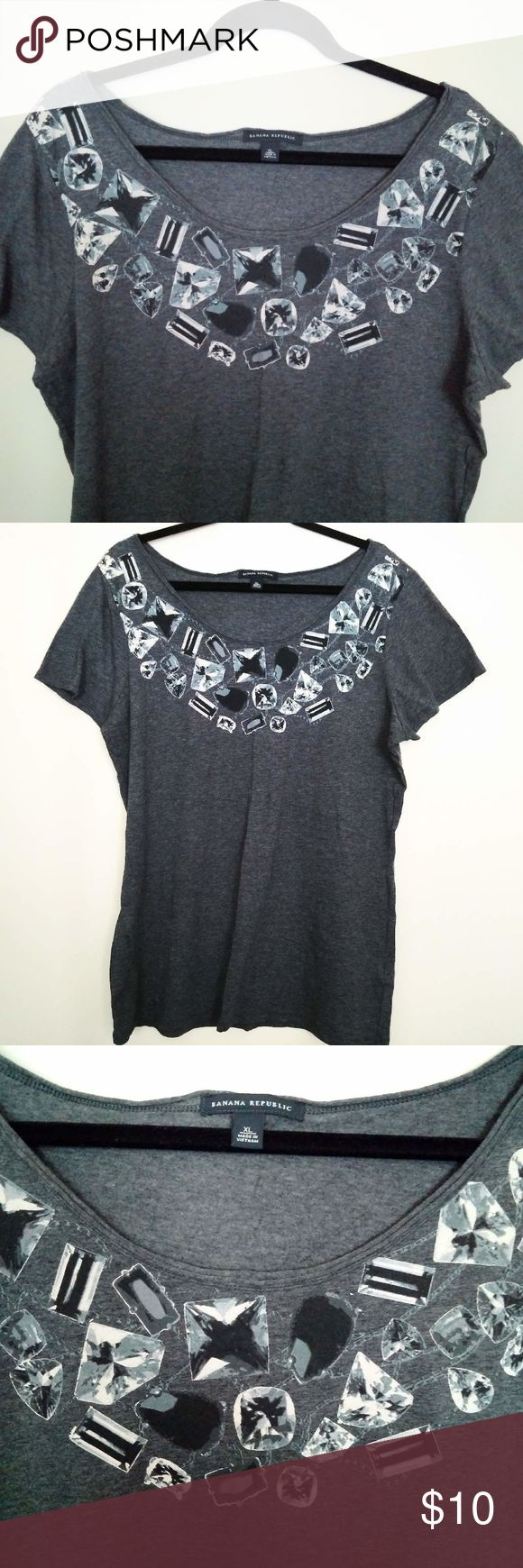 Banana Republic Gem Stone Graphic Scoop-neck Tee‎ Banana Republic Gem Stone Graphic Print Tee. Feel is soft cotton. Scoop-neck style. Short sleeve. Dark Gray/Charcoal color tee with black and white printed Gem stone design around neck to mimic a necklace. Women's  Size XL / Xtra-Large. NEW without tags.‎ Banana Republic Tops Tees - Short Sleeve